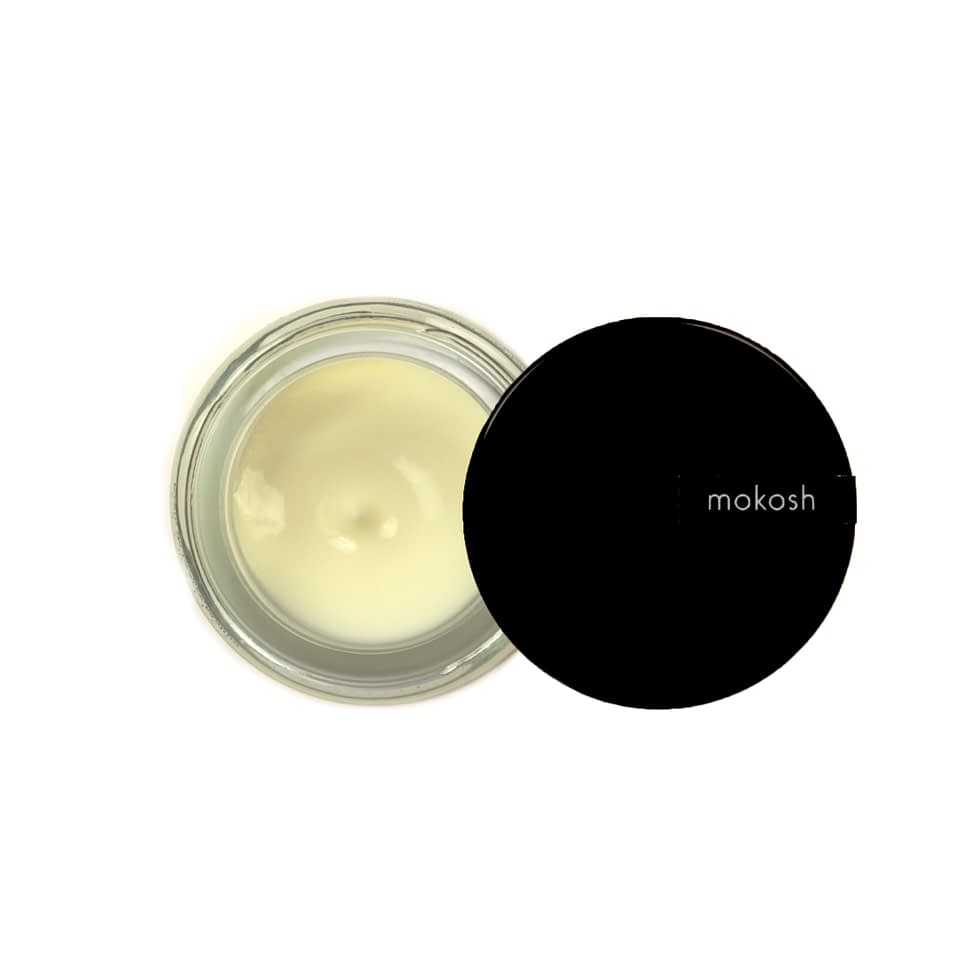 Anti-pollution face cream in a small glass jar from Mokosh Cosmetics.