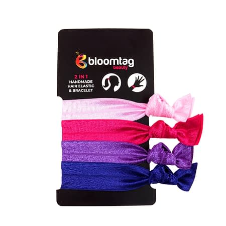 Bloomband Set of hair elastics in shades of pink, purple and navy blue.
