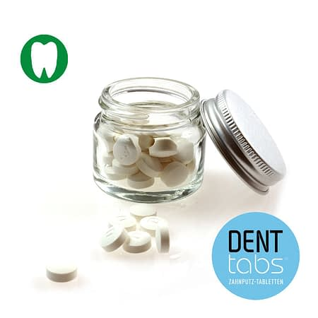 Denttabs toothpaste tablets with flouride in a glass jar. 28 tablets.