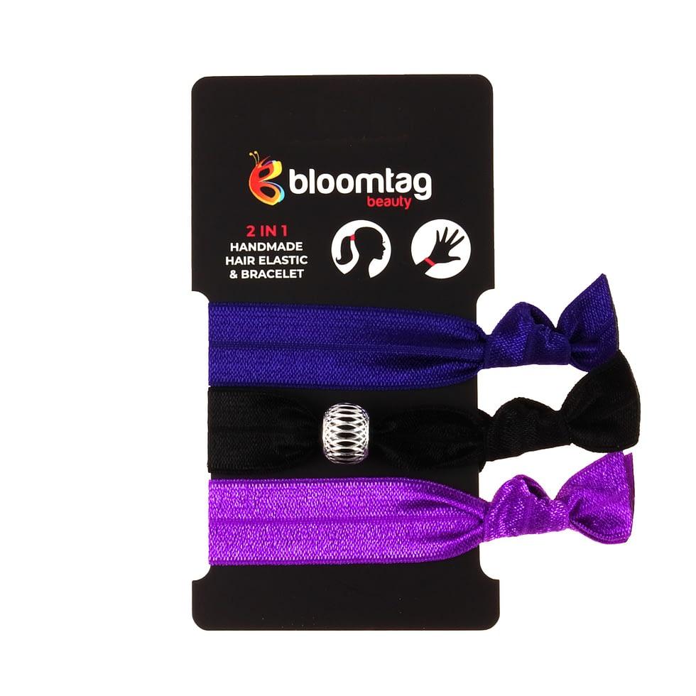 Zestaw gumek do włosów typu twistband w kolorach czarnym, fioletowym i granatowym.