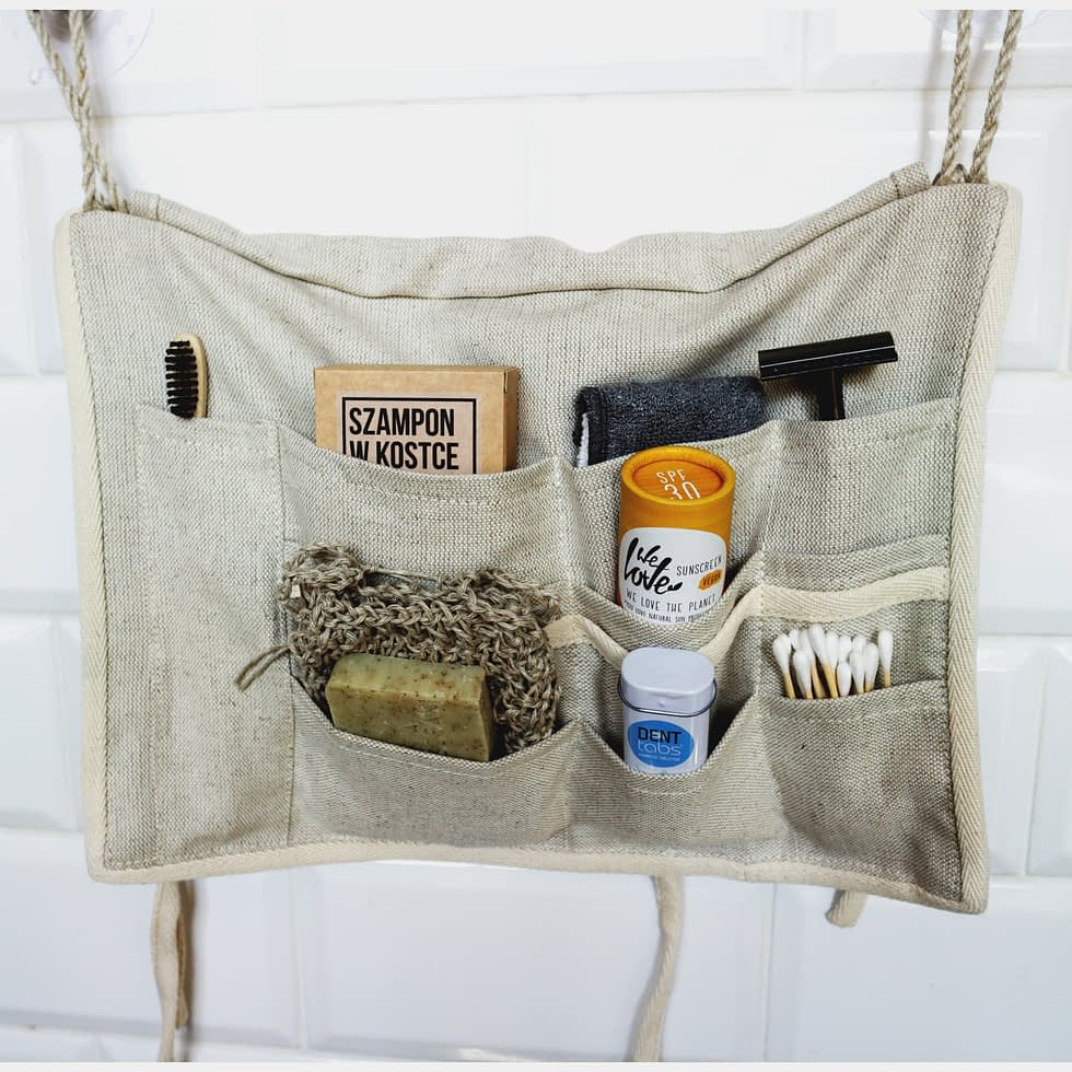 Rulonique cosmetic organizer hanging in the bathroom.
