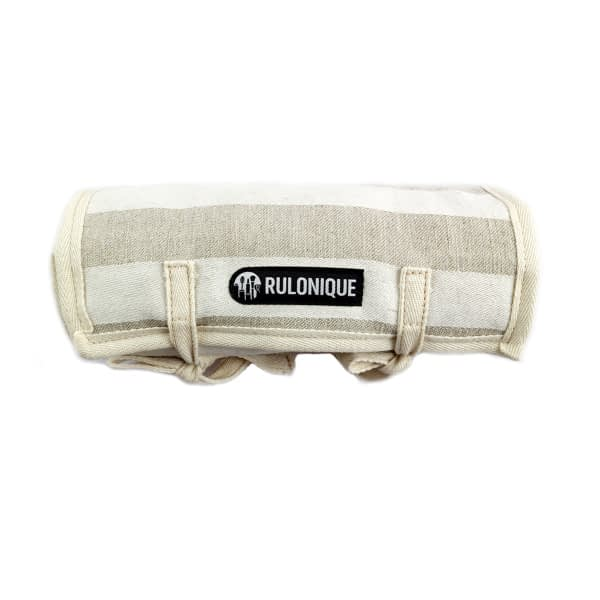 Linen roll up type cosmetic bag, captured in a rolled form with the logotype in front.