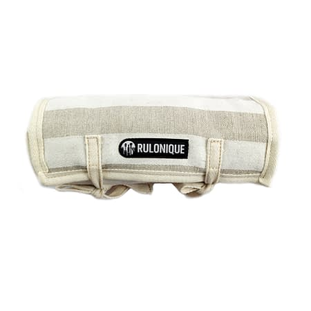 Rulonique linen cosmetic orgnizer. Rolled up showing its stripes and logo.
