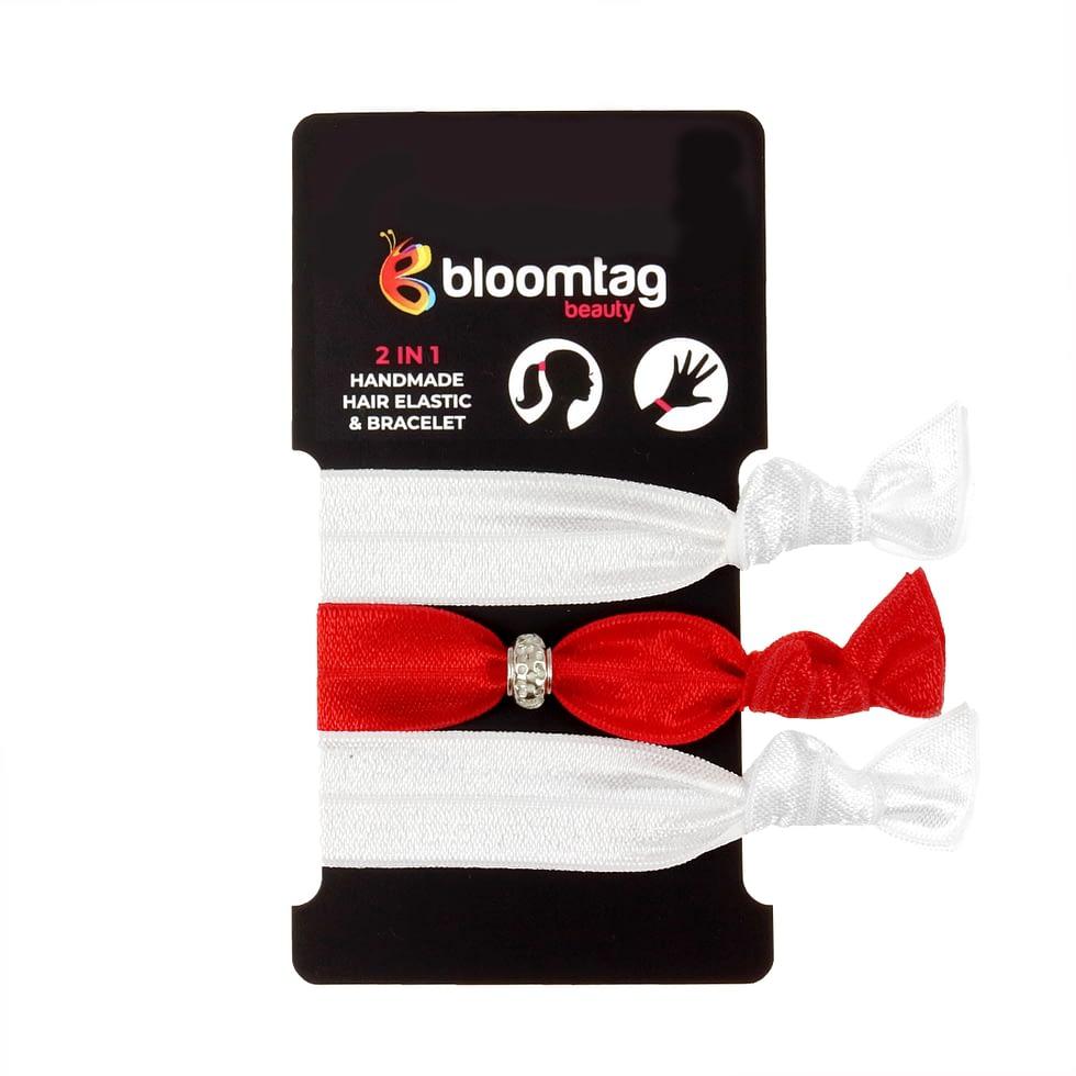 Zestaw gumek do włosów typu twistband w kolorze białym i czerwonym.